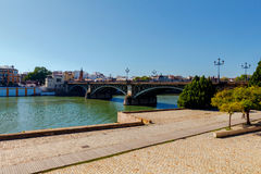 Sevilla. City embankment along the Guadalquivir. View of urban embankment in Seville along the Guadalquivir river by day. Spain. Andalusia stock photography