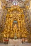 Sevilla - der Seitenaltar von Virgen de Las Aqua abgeschlossen in Jahr 1731 von den verschiedenen Künstlern in der barocken Kirch Lizenzfreie Stockfotografie