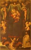 Sevilla - die Farbe Madonnas (Nuestra Senora de la Paz) im Seitenaltar von Kirche Iglesia De San Pedro durch Pedro Campana (1540) Lizenzfreies Stockbild