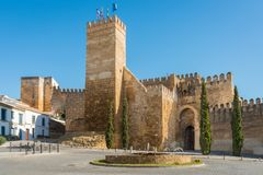Sevilla gate. Seville gate and tower in Carmona, Seville Royalty Free Stock Image