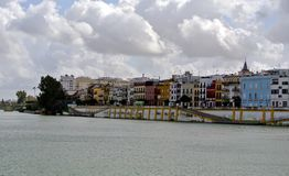 Heavy volumetric clouds over the Guadalquivir river line in Seville royalty free stock image