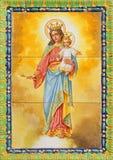 Sevilla - keramische mit Ziegeln gedeckte Madonna im Kirche Basilika del Maria Auxiliadora Lizenzfreie Stockfotografie