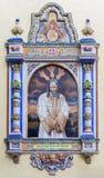 Sevilla - mit Ziegeln gedeckter Christus in der Bindung vorbei von 20 cent auf der Fassade der Kirche Iglesia San Juan de la Palm Lizenzfreie Stockbilder