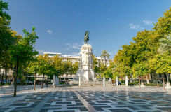 Sevilla. Monument to King Ferdinand. New Square, Plaza Nueva, with a monument to King Ferdinand III in the center, on a sunny summer day, Seville, Andalucia royalty free stock photo