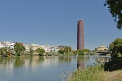 Sevilla Tower, office scycrapers along Guadalquivir river in Seville, Spain. Sevilla Tower, office scycrapers along Guadalquivir river on a sunny day with clear stock images