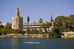 Sevilla tower. Image of 'torre del oro tower' in Guadalquivir river in Sevilla city. We can see a cabesa man in the boat royalty free stock image