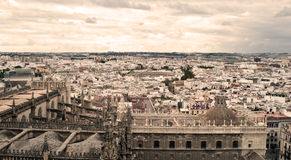Seville. Aerial view of the city of Seville, are the roofs of the buildings next to Each Other, it is a cloudy day the photo is taken from the tower of the Stock Photography