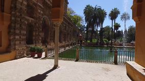 Seville, Andalucia, Spain - April 18, 2016: Alcazar, indoor gardens, courtyards and rooms