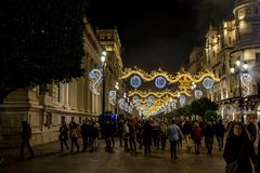 Families enjoying the christmas lights in Seville stock photo