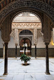 Seville, Arabic Arch as seen in Real Alcazar. An inner patio, typical spanish architecture feature, decorated with beautiful arabic arches in Real Alcazar Palace Stock Photography