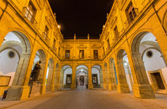 Seville - The atrium of University fromer Tobacco Factory at nig Royalty Free Stock Images