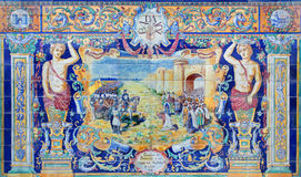 Seville - The Badajoz as one of The tiled 'Province Alcoves' along the walls of the Plaza de Espana Stock Photo