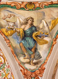 Seville - The baroque fresco of angel with the cup in church Hospital de los Venerables Sacerdotes Royalty Free Stock Images