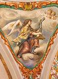 Seville - The baroque fresco of angel with the symbolic cross in church Hospital de los Venerables Sacerdotes Stock Photos