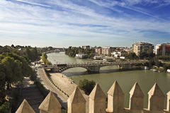 Seville Bridges of the Guadalquivir. View of the Bridge of San Telmo from the top of the Torre del Oro in Seville, Spain royalty free stock image