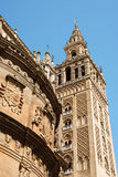 Seville Cathedral. Detail of La Giralda Tower and Seville Cathedral. The bell tower (La Giralda) was previously a minaret of the Berber Almohad period in Spain Royalty Free Stock Photos