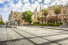 Seville cathedral from Constitution Avenue. Seville city center, Spain. Stock Photos