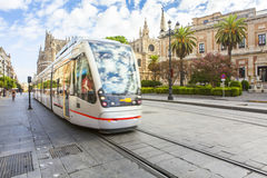Seville cathedral from Constitution Avenue. Tram in the street. Seville city center, Spain. Stock Images