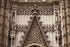 Seville Cathedral Ornamentation. Architectural details of the 15-16th century Gothic Cathedral of Seville in Spain, exterior ornamentation above entrance door Stock Images
