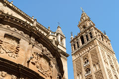 Seville Cathedral, Spain. Detail of the gothic and baroque Cathedral of Seville and the famous bell tower called La Giralda that was previously a minaret of the Stock Images