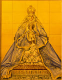 Seville - The ceramic tiled Madonna on facade of building Parroquia de Santa Cruz de Sevilla Royalty Free Stock Photos