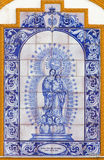 Seville - The ceramic tiled Madonna of Rosary on the facade of chapel Capilla dos de Mayo Royalty Free Stock Photos