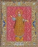 Seville - ceramic tiled Saint Philip Neri from 20. cent. by artist P. Navia on the facade of church Capilla de la Estrella. SEVILLE, SPAIN - OCTOBER 29, 2014 Royalty Free Stock Image