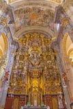 Seville - den barocka kyrkan av El Salvador (Iglesia del Salvador) med det huvudsakliga altaret (1770 - 1778) vid Cayetano de Aco royaltyfria bilder