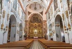 Seville - den barocka kyrkliga basilikadelen Maria Auxiliadora royaltyfri foto