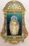 Seville - den keramiska belade med tegel Madonna på fadaden av kyrkliga Iglesia de Santa Maria de las Nieves Royaltyfria Foton