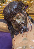 Seville -  The detail of carved Jesus Christ statue on the cross in church Iglesia de San Roque. Stock Photos