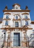 Seville - fasad av kyrkliga Sjukhus de la Caridad Fotografering för Bildbyråer