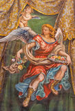 Seville - The fresco of angel with the roses in church Hospital de los Venerables Sacerdotes Royalty Free Stock Photos