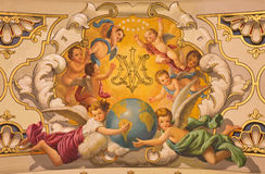 Seville - The fresco angels and the monogram of Virgin Mary on the ceiling in church Basilica de la Macarena. SEVILLE, SPAIN - OCTOBER 29, 2014: The fresco Stock Image