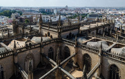 Seville from the Giralda, Cathedral, Andalusia, Spain. View from the belfry Giralda to the Seville Cathedral and the modern buildings of Seville, Andalusia Stock Image