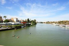 Seville, Guadalquivir river & buildings landscape stock image