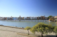 Seville on the Guadalquivir river. Guadalquivir river with riverside buildings in Seville, Spain royalty free stock photography