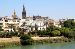 Seville and the Guadalquivir River, Spain. View of Seville over the Guadalquivir River, On the right the rounding of the 18th century Plaza de Toros de la Real royalty free stock photos