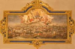 Seville - målarfärgen av striden av Lepanto från 7 10 1571 i den kyrkliga Iglesiaen de Santa Maria Magdalena Royaltyfri Foto