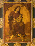 Seville - The Madonna paint on the wood in church Iglesia de San Pedro by unknown painter. Royalty Free Stock Image