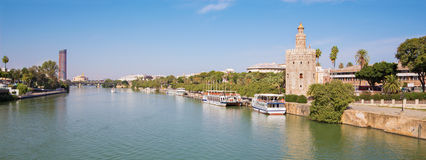 Seville - The medieval tower Torre del Oro and modern Torre Cajasol in background Stock Image
