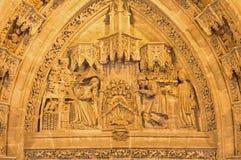 Seville - narodzenie jezusa scena na Puerta San Miguel na Katedralnym De Santa Maria de losie angeles Sede Fotografia Stock