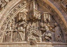 Seville - The Nativity scene on the Puerta San Miguel on the Cathedral de Santa Maria de la Sede Stock Image