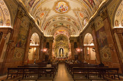 Seville - The nave of church Basilica de la Macarena with the frescoes by Rafael Rodrguez Stock Image