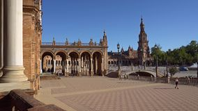 Seville,plaza de epana. Seville,Spain-august 7,2017:tourists stroll and admire the famous plaza de Espana in Seville during a sunny day stock footage