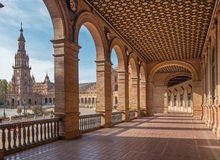 Seville - The portico of Plaza de Espana square designed by Anibal Gonzalez (1920s) in Art Deco and Neo-Mudejar style. Royalty Free Stock Images