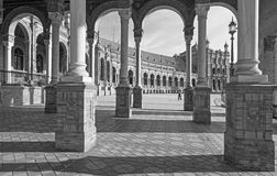 Seville - The portico of Plaza de Espana square designed by Anibal Gonzalez (1920s) in Art Deco and Neo-Mudejar style. Stock Photos