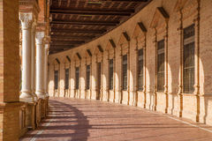 Seville - The porticoes of Plaza de Espana square designed by Anibal Gonzalez (1920s) in Art Deco and Neo-Mudejar style. Royalty Free Stock Photography
