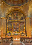 Seville - The Presbytery and main altar with the central paint the Adoration of shepherds in church Iglesia de la Anunciacion. Royalty Free Stock Images