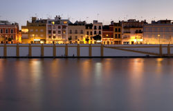 Seville riverside. View at Calle Betis in Seville (Spain) from the riverside of the Guadalquivir at dusk, with atmospheric lights stock image